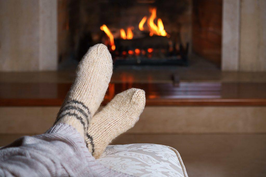 Feet warming by a fire