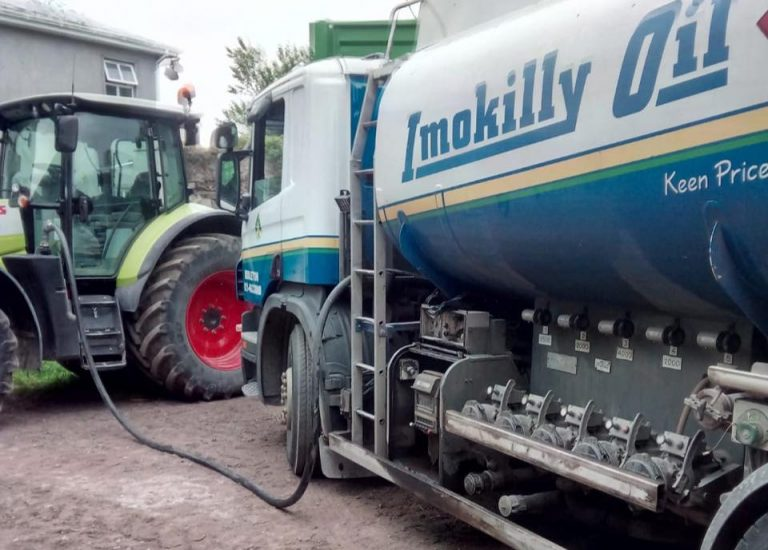 Re filling a tractor with fuel